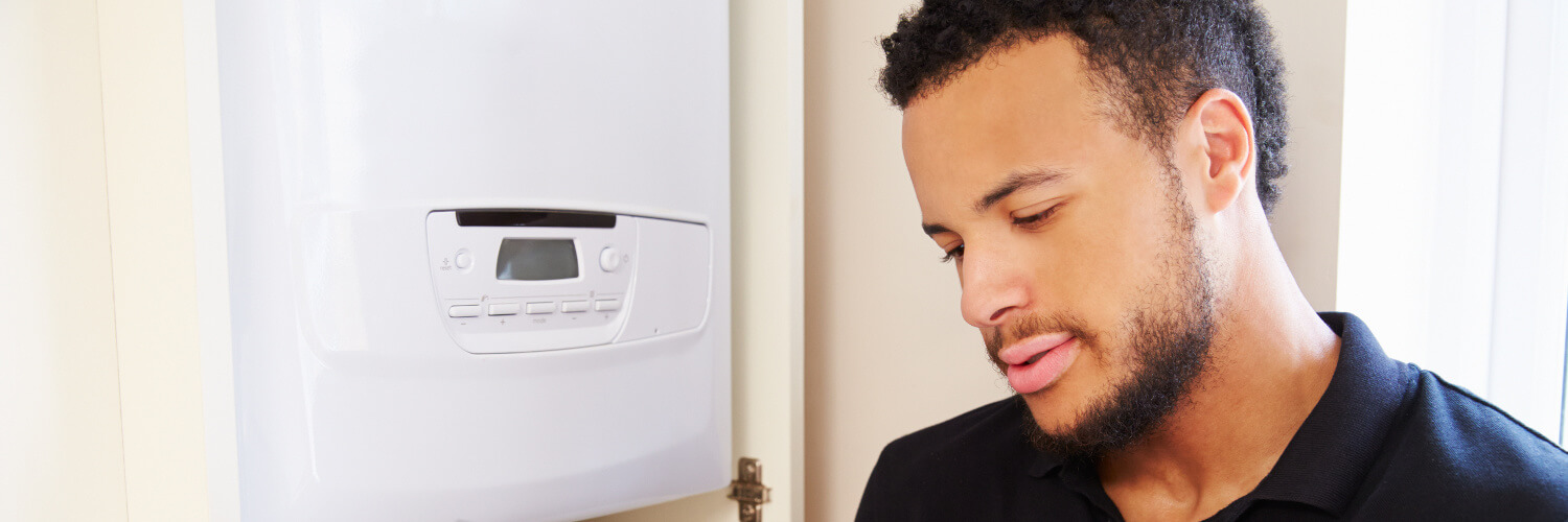 Professional carrying out a combi boiler installation