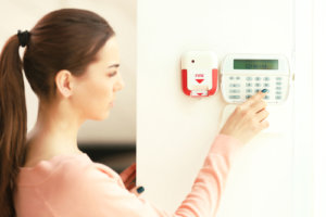 woman setting alarm system